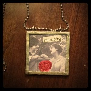 Hand crafted necklace. I bought it at the Art Fair